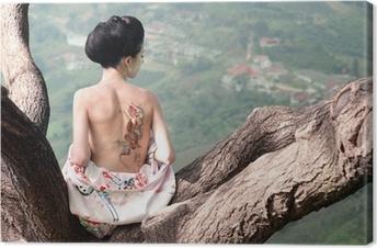 Leinwandbild Frau mit Schlange Tattoo sitzt auf Ast (Orig.)