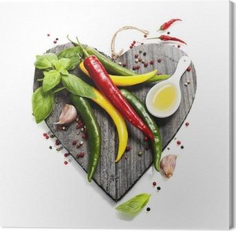 Leinwandbild Frisches Gemüse auf herzförmige Schneidebrett