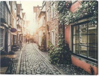 Leinwandbild Historische Straße in Europa bei Sonnenuntergang