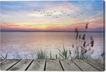 Leinwandbild Holzsteg bei Sonnenuntergang