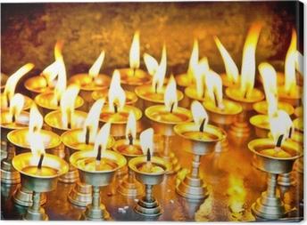 Leinwandbild Kerzen bei swayambhunath Tempel in Nepal