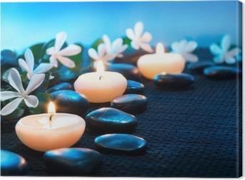 Leinwandbild Kerzen und schwarzen Steinen auf schwarz matt