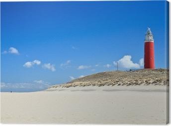 Leinwandbild Leuchtturm in den Dünen am Strand