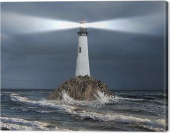 Leinwandbild Leuchtturm mit einem Lichtstrahl