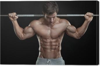 Leinwandbild Muskulös Bodybuilder Kerl machen Übungen mit Hanteln über bla