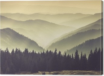 Leinwandbild Neblige Berghänge