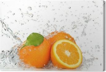 Leinwandbild Orange Früchte und Spritzwasser