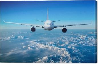 Leinwandbild Passagierflugzeug in den Himmel