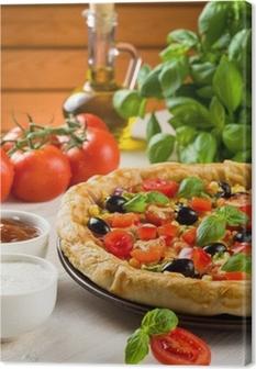 Leinwandbild Pizza auf Holztisch