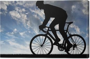 Leinwandbild Silhouette der Radfahrer fahren ein Rennrad bei Sonnenuntergang