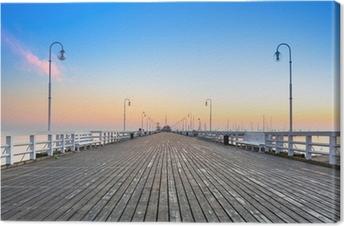 Leinwandbild Sonnenaufgang auf hölzerne Pier in Sopot über die Ostsee, Polen