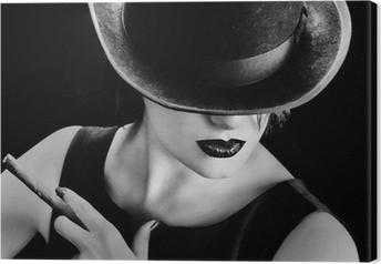 Leinwandbild Vintage Frau mit einem Hut und Zigarre