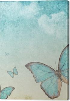 Leinwandbild Vintage Hintergrund mit einem blauen Schmetterling