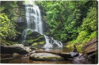 Leinwandbild Wasserfall mitten im Waldgrün