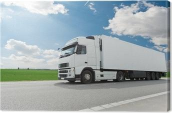 Leinwandbild Weiß Lastkraftwagen mit Anhänger über blauen Himmel