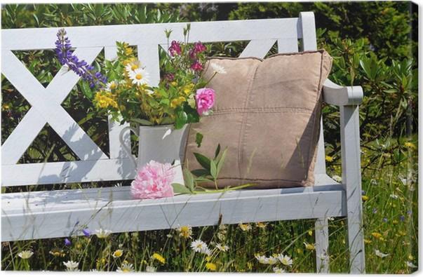 Leinwandbild Weiße Gartenbank Auf Einer Blumenwiese