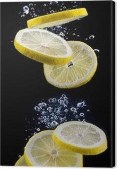 Leinwandbild Zitronenscheibe im Wasser