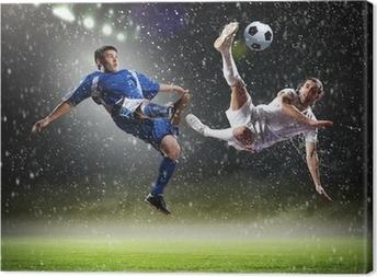 Leinwandbild Zwei Fußballspieler Schlagen des Balles