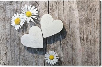 Leinwandbild Zwei weiße Herzen & Gänseblümchen