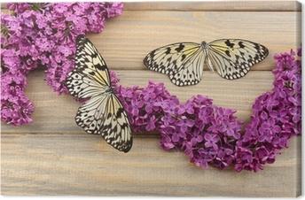 Lerretbilde Vakre sommerfugler og lilla blomster, på trebakgrunn