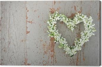 Lerretsbilde Hjerteformet blomsterkrans av lilys i dalen