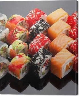 Lerretsbilde Japansk mat. Sushi satt over svart bakgrunn.