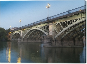 Lerretsbilde Triana Bridge, den eldste broen i Sevilla ved skumringen