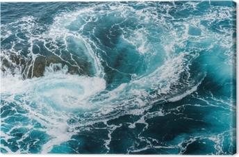 Lerretsbilde Vertiginous, hvirvlende skummende vannbølger ved havet fotografert ovenfra