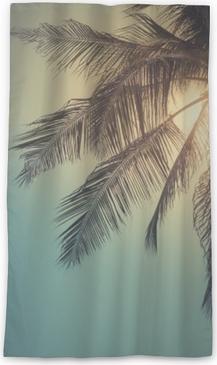 Lichtdurchlässiger Fenstervorhang Spitze der Palme mit Sonne hinten