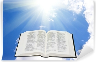 Mural de Parede em Vinil Holy bible in the sky illuminated by a sunlight