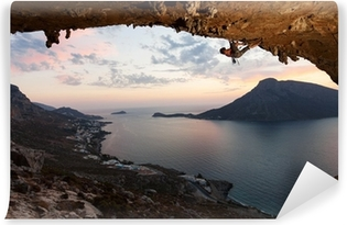 Mural de Parede em Vinil Silhouette of a rock climber at sunset. Kalymnos Island, Greece.