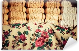 Mural de Parede em Vinil Traditional polish smoked cheese oscypek on market in Zakopane