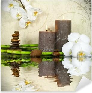 Naklejka Pixerstick Biała orchidea z bambusa i świec i kamienie