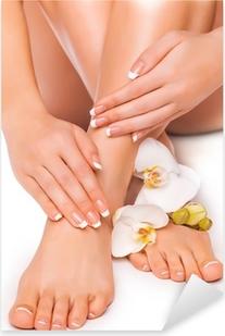 Naklejka Pixerstick Manicure i pedicure z białych orchidei. odizolowany