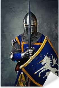 Naklejka Pixerstick Średniowieczny rycerz na szarym tle.