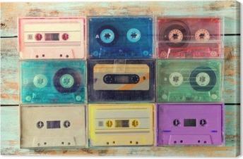 Obraz na Plátně Pohled shora (viz výše) záběr retro kazety s páskou na dřevěném stole - vintage barevné styly efekt.