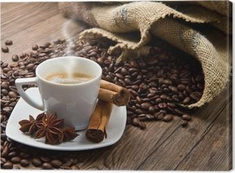 Obraz na plátně Šálek kávy s pytlem pytlovina pražených bobů na rustikální stůl
