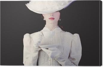 Obraz na płótnie Kobieta w białych ubraniach ery wiktoriańskiej z filiżanką herbaty