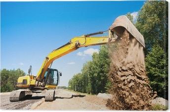 Obraz na płótnie Koparka rozładunku piasku podczas prac budowlanych drogowych