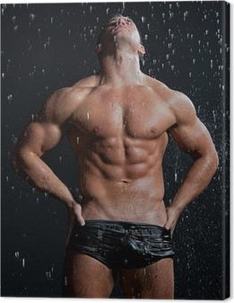 Obraz na płótnie Mięśni mokre sexy młoda nagi mężczyzna stwarzających w deszczu w studio