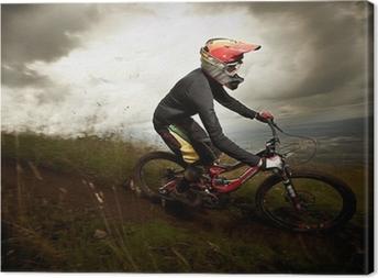 Obraz na płótnie Młody człowiek na rowerze górskim stylu downhill