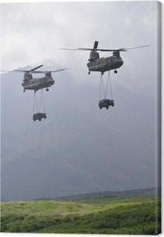 Obraz na płótnie Śmigłowce transportujące samochody