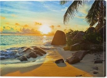 Obraz na płótnie Tropikalnej plaży o zachodzie słońca
