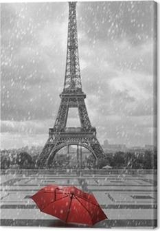 Obraz na płótnie Wieża Eiffla w deszczu. czarno-białe zdjęcie z czerwonym elementem