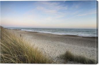 Obraz na Płótnie Zachód słońca na plaży