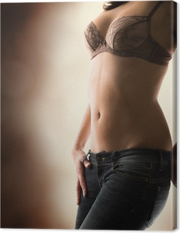 Obraz na płótnie Zmysłowa kobieta w biustonosz i dżinsy - ciemność