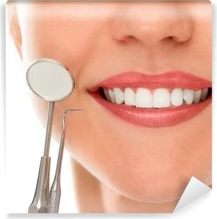 Papier peint vinyle À un dentiste avec un sourire