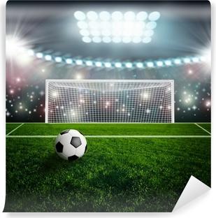 Papier peint vinyle Ballon de soccer sur scène du stade vert