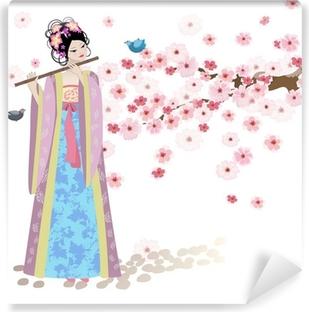 Papier peint vinyle Belle fille Oriental près de cerisiers en fleurs