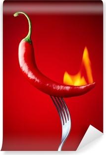 Papier peint vinyle Brûler piment rouge sur fond rouge